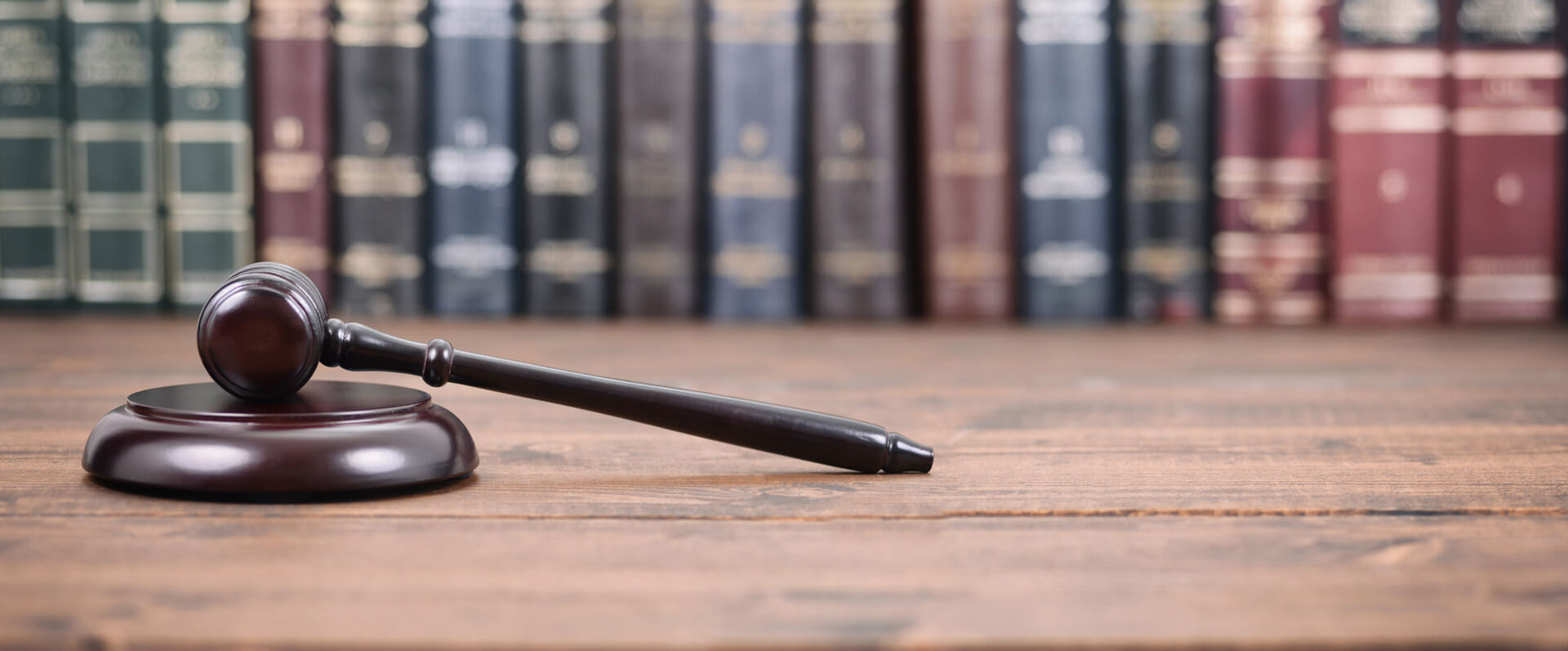 Judge Gavel on a wooden background, Law library concept.